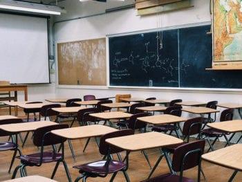 Line of desks in classroom.