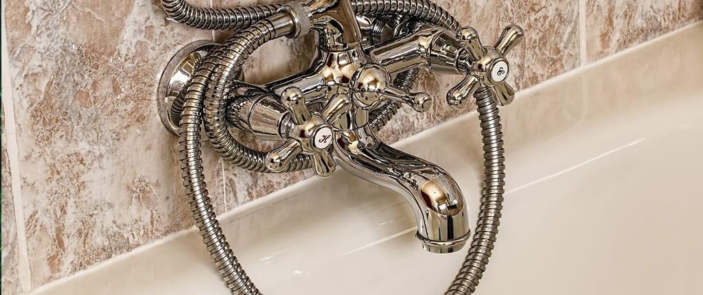 Silver bath tub faucet.