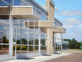 Line of glass business doors with awnings.