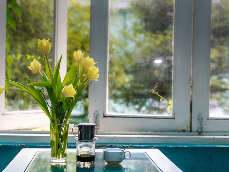 Open kitchen window with flowers