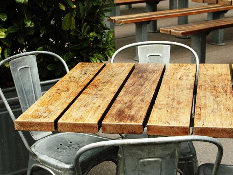 Wooden table with metal chairs outside